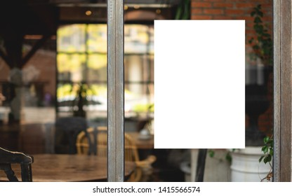 Mockup white paper or white promotion poster displayed on the front of the restaurant, coffee shop Promotion information for marketing announcements and details