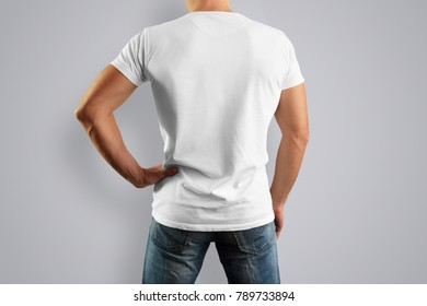 Mockup  in a white T-shirt is looking from the back. design for clothes.