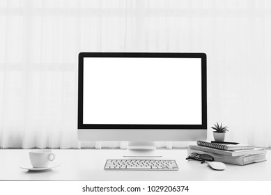 Mockup workspace with desktop blank screen computer on white table