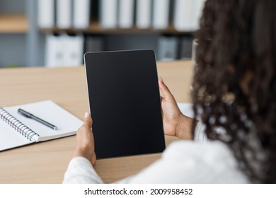 Mockup young business woman using smart tech with screen blank on desk, use device internet for working, business, study and education. African american lady looking at devise, close up, pov, cropped