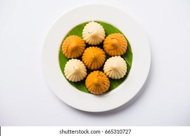 A modak is an Indian sweet dumpling popular in India. It is called modak, Kozhakkatta, modhaka, kadubu, modhakam, kozhakkattai, kudumu. made up of coconut and jaggery, rice flour, wheat with khava