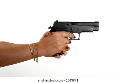 model aims a 9mm handgun to the right with two hands