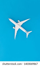 Model airplane on blue pastel color background,Top view