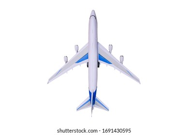 Model airplane on a white background. Toy airplane, top view. Passenger liner for flying around the world. Travel and tourism.