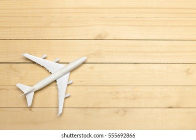 Model airplane on the wooden background