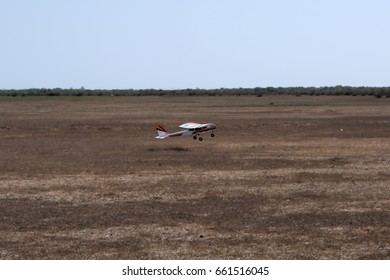 A model airplane stunt plane spinning. Model: tri 60