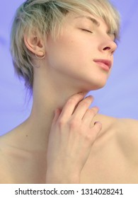 Model with ash blond hairstyle and closed eyes on purple background. Lady accenting on hand and fingers. Girl with naked neck and shoulders with clavicles