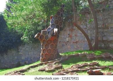 model Bee and waist honeycomb in the garden.