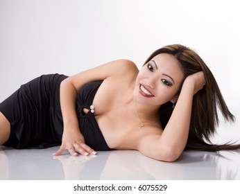 Model in black dress on  floor