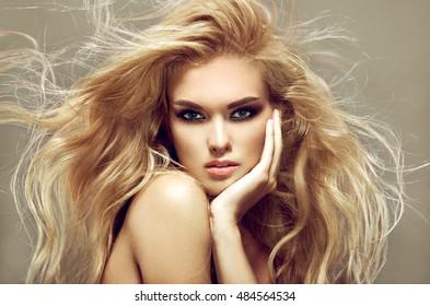 Model blonde girl. Beautiful brown hair Girl. Healthy Long Hair.