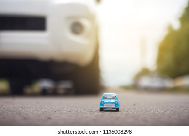 model car parked at the road with bokeh background, small toy car.