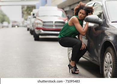 Model checking her makeup in the car mirror