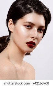 Model with chic lips make-up with red lipd long lashes
