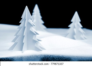model Christmas landscape with kirigami, fold and cut, trees, snow and ice