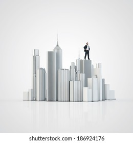 Model of a city and businessman standing roof of building