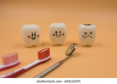 Model Cute toys teeth in dentistry on a yellow background.