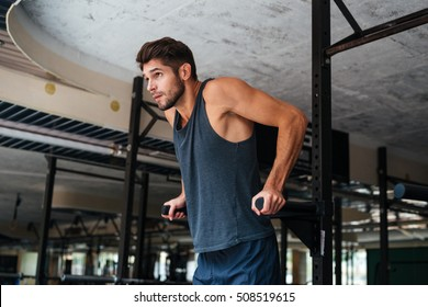 Model doing exercises in the gym. looking away