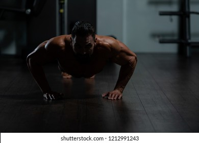 Model Doing Push Ups As Part Of Bodybuilding Training