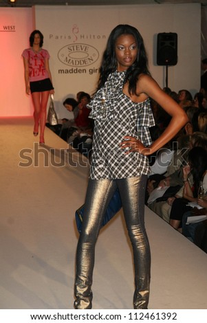 d31a9904d6a Model at the fashion show debut of Paris Hilton s Clothing Line by Steve  Madden. California
