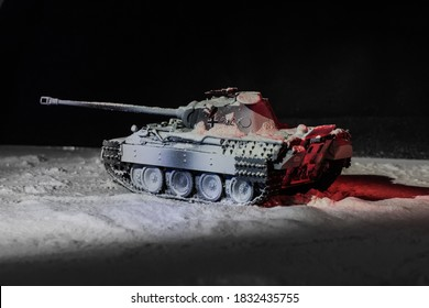 Model of a German Panther medium tank abandoned by the crew in winter camouflage in the snow