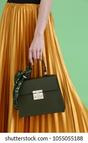 Model holds fashion handbag
