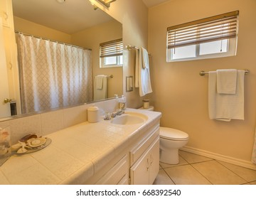 Model homes always show off beautiful bathrooms with clever design