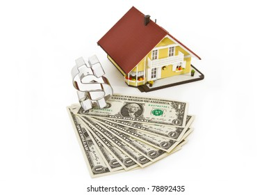 Model house with dollar banknotes and  on bright background