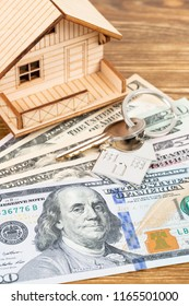 Model house and dollar money banknote concept for mortgage