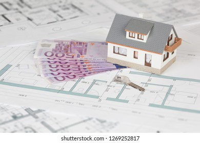 Model house on blueprint background and five hundred euro banknote