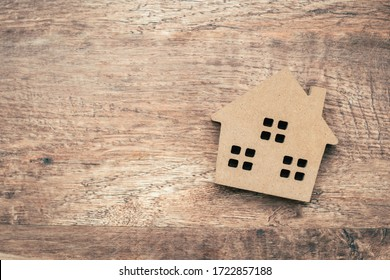 Model house on wooden background.investment insurance and home purchase mortgage concept