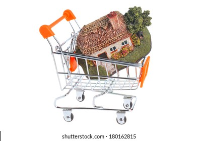 Model of house in the shopping cart isolated on white background
