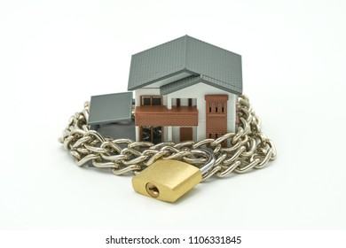 Model house wrapped with steel chain and padlock. Ideas Security. using as background business concept and Security concept with copy space.