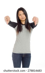 Model isolated on plain background in studio with thumbs down