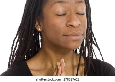 Model isolated on plain background in studio wishing praying
