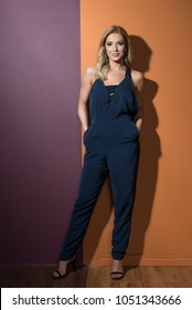 Model in a Jumpsuit Against a Two Toned Wall