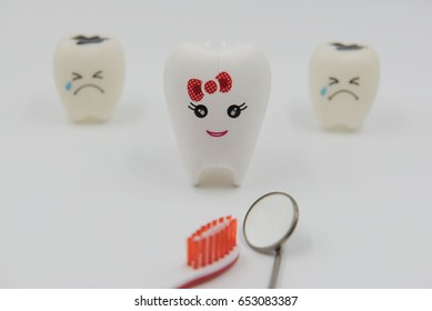 Model  lady smile Cute toys teeth in dentistry on a white background.