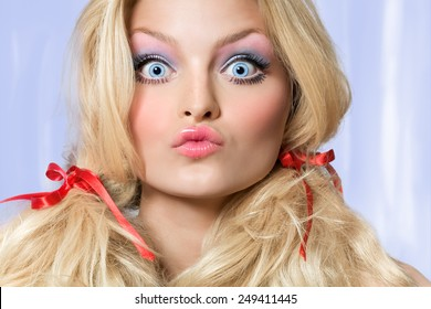 Model looking like a doll making faces.