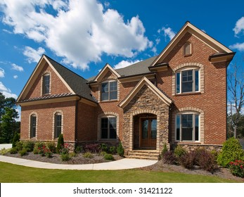 Model Luxury Home Exterior with clouds side view