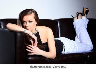 Model lying on a sofa