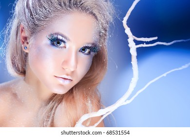 Model with makeup in blue tones