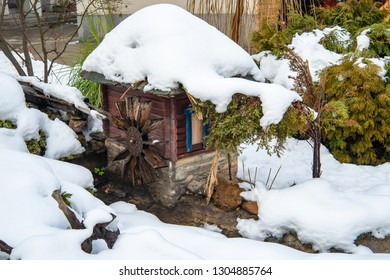 model of a mountain house and mill covered with snow