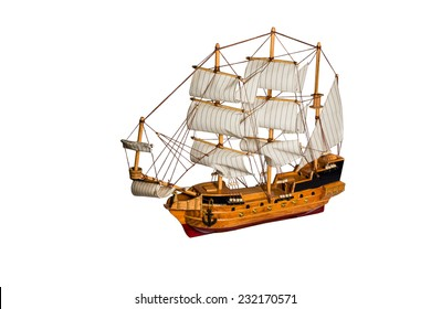 Model of the old sailing merchant ships with cannons and masts isolated on white background