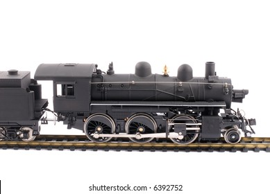 Model Of An Old Time Steam Train, Isolated Over White