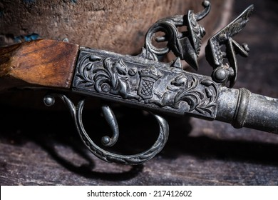 Model of the old vintage gun on wooden background