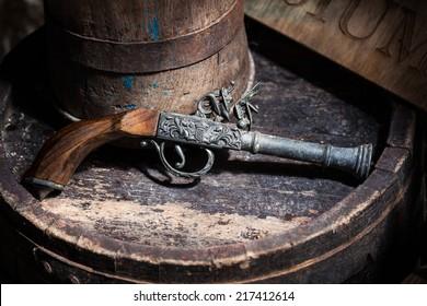 Model of the old vintage gun on wooden background