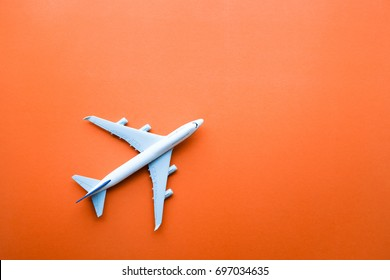 Model plane,airplane on pastel color background.Flat lay design.