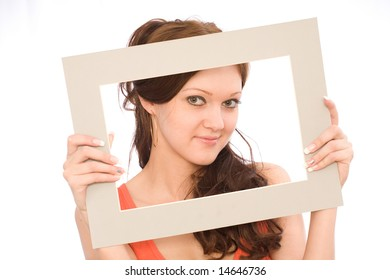 The model poses for the photographer on a white background, a studio shot