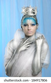 Model posing with creative make up and body painting as Ice Queen