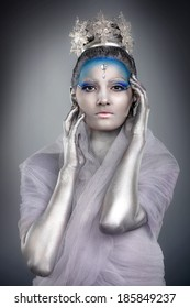 Model posing with creative make up and body painting as Ice Queen or Snow Fairy