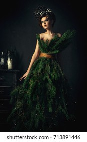 Model posing in a dress, which looks like a Christmas tree